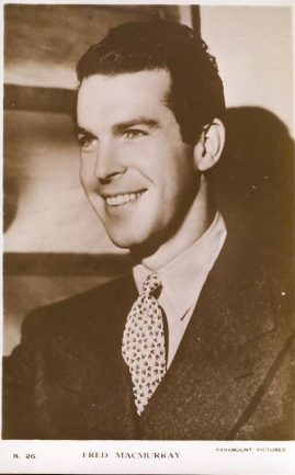 Fred MacMurray Paramount Pictures photo postcard. An original postcard in good condition for its age. Handling crease to front. Please see large photo and description for details. ref133