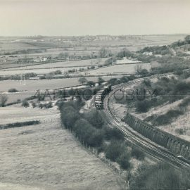 UK GB Black & White Train Photo as shown - W.A.Sharman - reverse side picture has full details - 'CORBY TUNNEL 19.03.87 unidentified class 31 heads down to the Welland Valley with a stone train'  - approx measurements 25cm x 20cm (10 x 8 inches) in Very Good Condition. Photo watermarked with a dotted line and our name. This is not on the actual photographs of the train / railway / locomotive / Railway Station etc