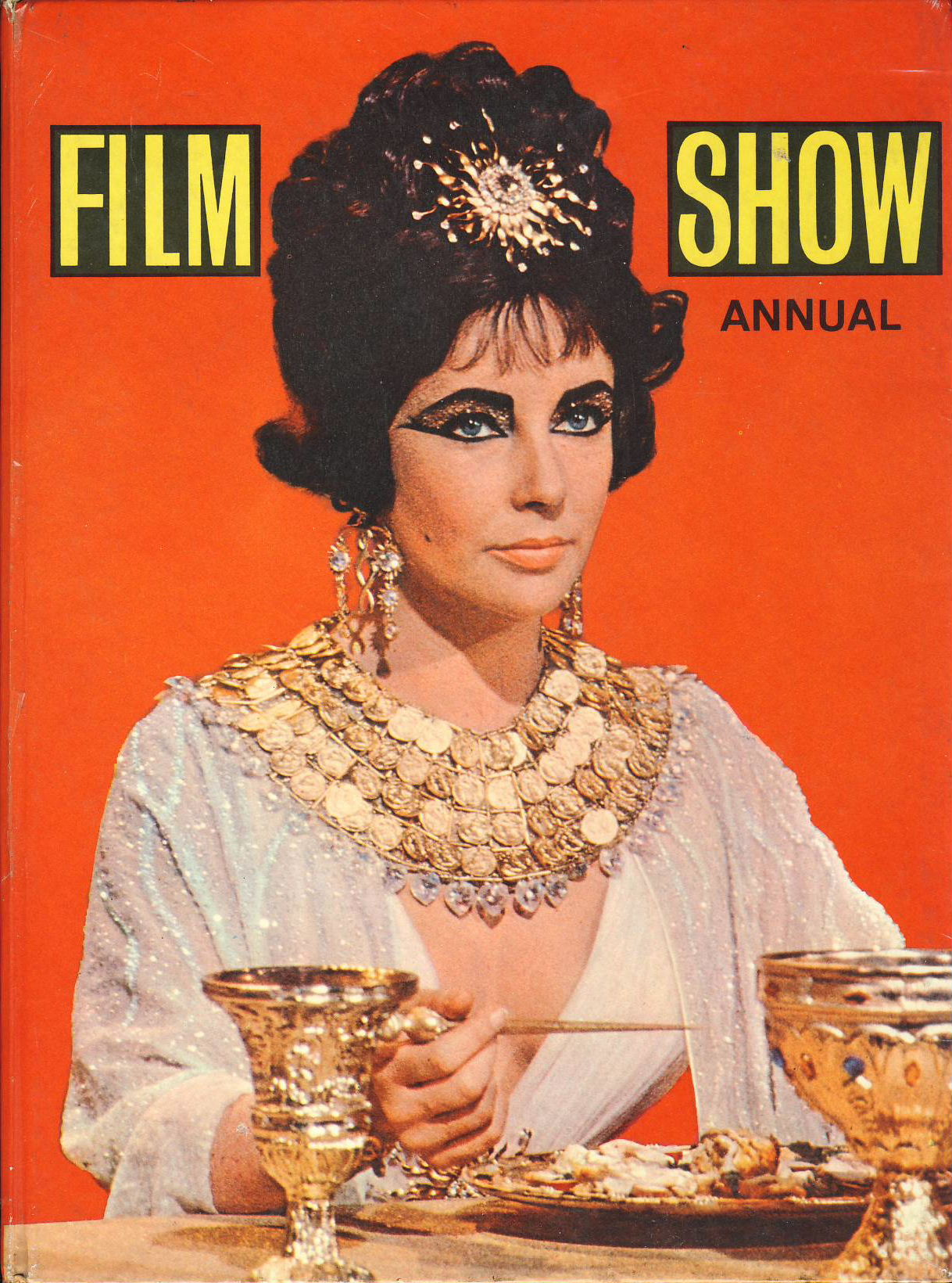 FILM SHOW ANNUAL Elizabeth Taylor on cover 1962 PURNELL HB book ref366 100 pages of photos and articles of the film stars dated 1962 Purnell & Sons Ltd. Edited by Ken Simmons. Pre-owned book in  good condition for age. Please see large photo for more details.