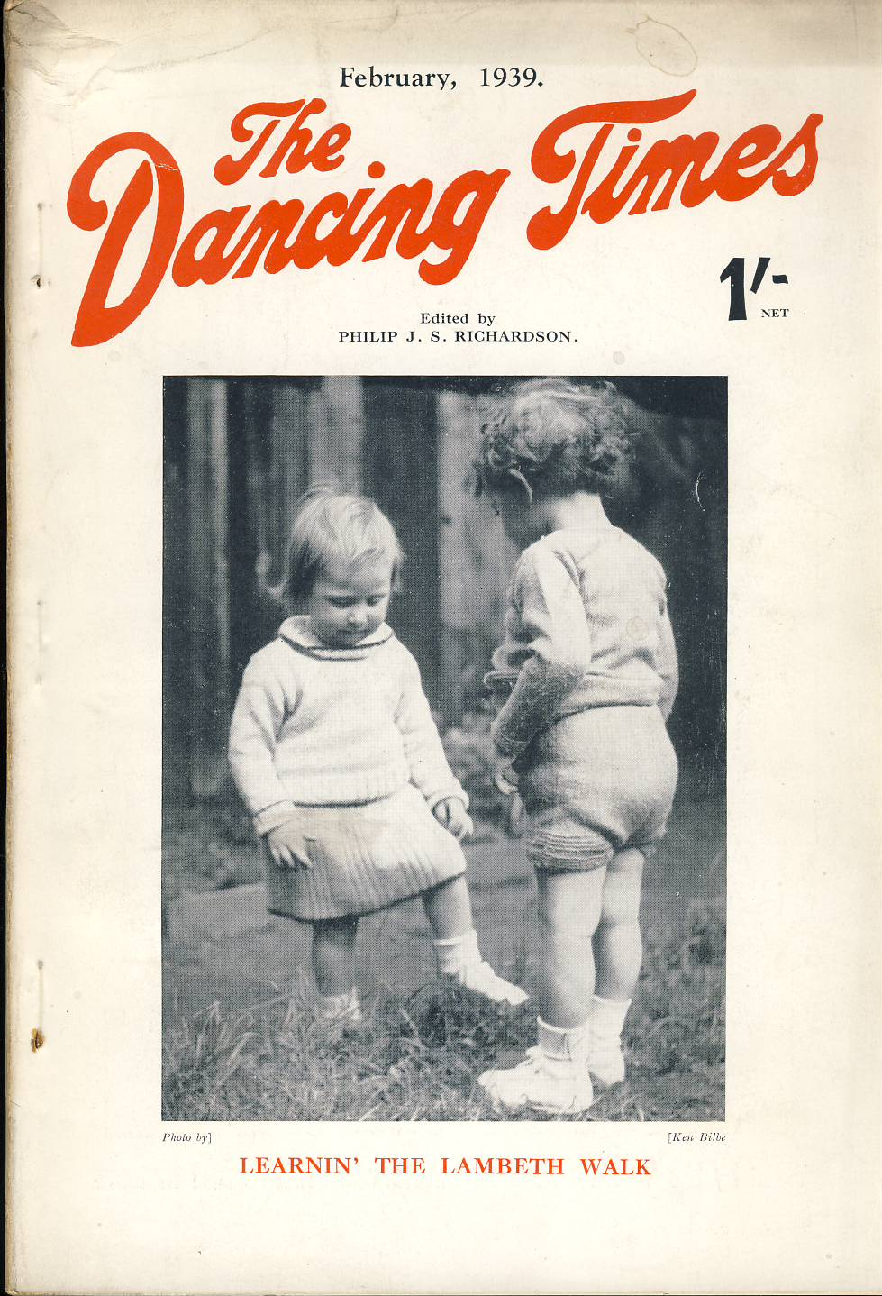 February 1939 The Dancing Times magazine Toddlers Learning the Lambeth Walk FREDDIE CARPENTER photo on inside front cover. A review of dancing in its many phases - containing articles and photos. Some vintage adverts for dancing schools. This is a vintage magazine. Text and photos clean and bright inside. The covers are badly marked with scuffs and tears to spines. Staples rusting so cover coming away from text. Please read the full description and see photo.