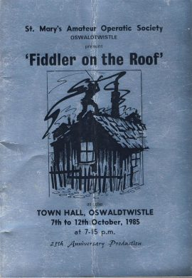 1985 OSWALDTWISTLE Theatre programme Fiddler on the Roof TOWN HALL ref0064 A1 St Mary's Amateur Operatic Society Oswaldtwistle Lancashire 25th Anniversary Production - silver effect cover.  Pre-owned item. Measures approx  15cm x 22cm 28 pages with some lovely old local adverts. Full cast list and a full company photo.