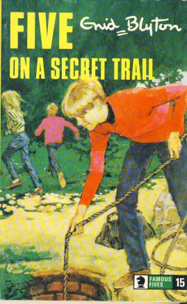 The Famous Five ON A SECRET TRAIL 1976 Enid Blyton vintage paperback book Book number 15. Cover illustration by Betty Maxey KNIGHT paperback book pre-owned in very good used condition. Please see photos for details.